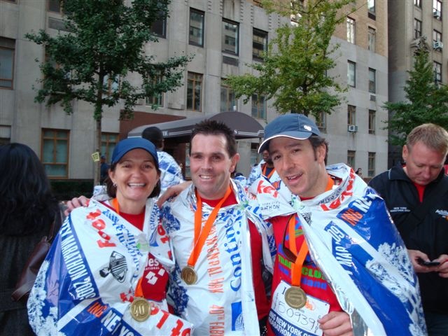 Laurie, Harris and Mike after NY marathon 2009 photo. Click to enlarge