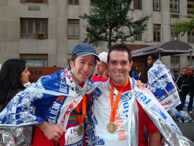 Mike and Harris at the finish of the New York City Marathon 2009 photo. Click to enlarge