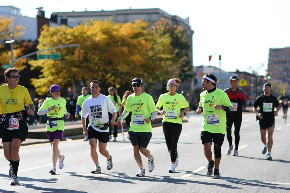 Mike and guiding team running during 2011 New York City Marathon photo