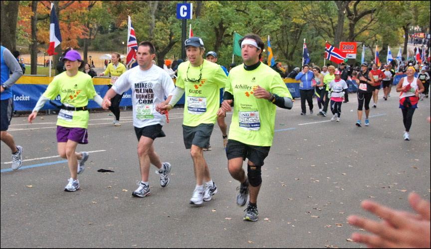 Mike and guide team running up to the finish line of the 2011 New York City Marathon. Photo provided by Lawrence White