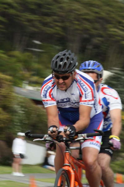 Mike and Lloyd cycling on tandem bike while competing in the Panasonic People's Triathlon November 2008 photo