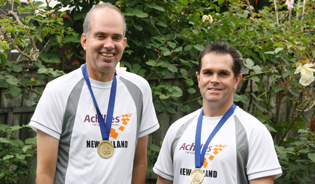Mike and Martin wearing medals. - Photo by Ben Watson