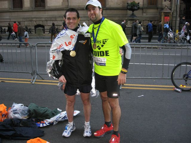Mike and Drew at the finish of the New York City Marathon 2010 photo. Click to enlarge